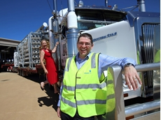 Mr Carmine Ciccocioppo, Chief Operating Officer and Helen Bailey, General Manager Marketing and Human Resources watch as 11 trucks leave Osmoflo's Burton facility