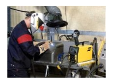 Welding with a portable welding machine.