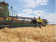 Brothers Alton and Lyndon Pfeffer take a break during wheat harvest in November