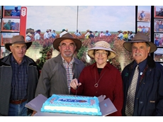 Mel Anderton, Malcolm & Dianne Campbell, and Bill Smith cutting the cake at Wednesday's trial co-operator meet