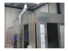Dry spray booths being used for capturing and filtering paint overspray