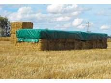 Ratch-e-tarps provide effective protection to hay bales in heavy rain and winds