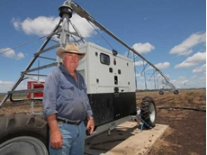 Bill Bowen with his irrigation system powered by a Yanmar 4TNV98 diesel engine
