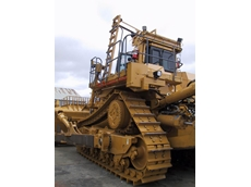 Elevating platform system for tracked dozers was designed to provide safe access to the operators cab