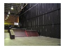 A massive soundproofing curtain stops noise from the Monster Skate Park escaping into the Sports Hall half of the complex at Sydney's Olympic Park