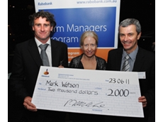 Mark and Amanda Watson receiving the Rabobank 2011 Farm Managers Program award with Rabobank general manager Country Banking Australia Peter Knoblanche
