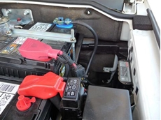 BCDC 1220 Vehicle Battery Charger in a Pajero Engine