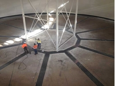The water tank floor showing repaired seals between concrete segments and between the steel walls and ring beam