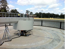 A waste water treatment plant settlement tank being prepared for protection by a sprayed Pure Polyurea coating