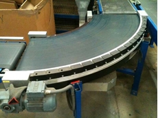 Power turn belts are used in airline baggage and package handling applications