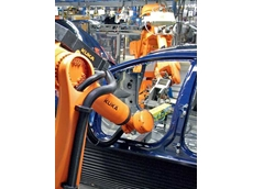 Sensor and camera technology from SICK in use at Ford: The robot screws the airbag module in the passenger compartment