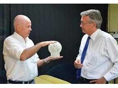 SOS Components Director Jeff Condren presents the Hon. Wayne Swan MP with the 'Man in a ball in a ball' prototype for better understanding of Rapid Prototyping concepts