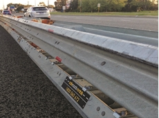 Ironman Hybrid barrier system protecting a work zone on a main road