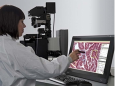 MMI CellScan microscopy based slide scanner