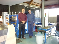 A top and bottom hot melt sealer being commissioned by Paul Braddock, with Nick Roy of Kreglinger Wine Estates