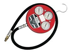 Quadrigauge pressure testing device
