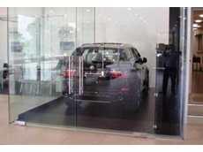 Southwell car hoist within a glass enclosure at Adelaide BMW showroom