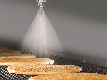 PulsaJet - Nozzles Applying Mould Inhibitor onto Pizza