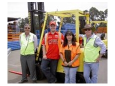 Winners of the first round of forklift heats