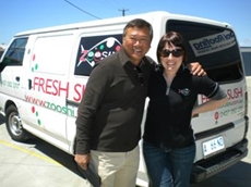 Melvin and Kelly with Zooshi's delivery van