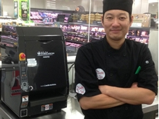 Steve Chan, Franchisee of Sushi Izu Newstead inside Woolworths Supermarket with his new Autec ASM835E Rice Sheeter sushi machine