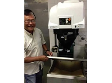 Melvin of Sushi Machine showing the stored rice inside the Kobota Rice Washer KP-90KN
