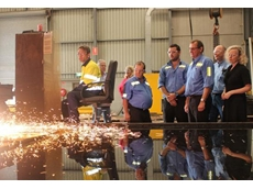 Glenn Woods, Jamie Woods, Tom Woods and Labor Federal candidate for Newcastle Sharon Claydon watch operator Stuart Hamilton, left, plasma-cut a chromium carbide liner