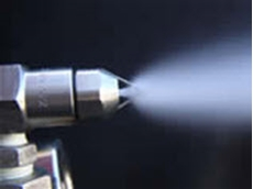 Ultrasonic air atomising spray nozzles