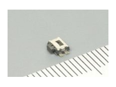 ALPS side-push tact switch.