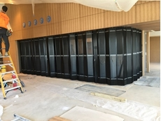 ATDC installs 300mm wide panel closure doors for Sydney yacht club bar