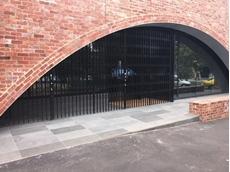 ATDC's S08 curved steel retractable commercial security door at the Baptist Church Community Hall