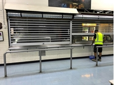 ATDC's clear roller shutters secure Woolworths depot servery