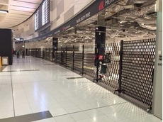 Heinemann has installed nearly 600 lineal metres of ATDC's portable, expandable, rollaway security barriers/doors to secure its store at Sydney International Airport