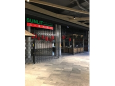 Sunlit Asian Supermarket featuring ATDC's shopfront door