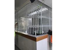 Curved steel door secures hexagonal bar counter at Skyring Terrace kiosk