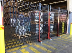 Expandable fencing securing bonded warehouses