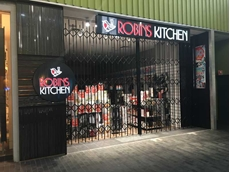Leading Australian retailer installs space efficient concertina security doors at stores