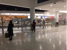 Portable barriers blend in with Wolfgang Puck's restaurant at LAX airport