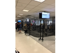 Safety fencing controls access at American Airlines gate in Sydney