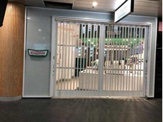 Krispy Kreme at Chatswood Interchange featuring ATDC's folding security shutters in gloss white finish