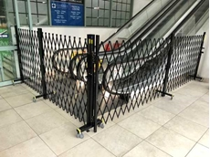 Public access through travelators and escalators is efficiently controlled using ATDC's temporary barriers