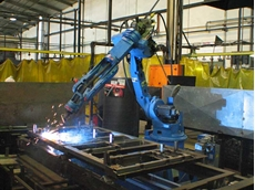 A robotic welder at the new ATDC office