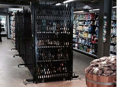 Woolworths secures liquor aisles with portable expanding barricades