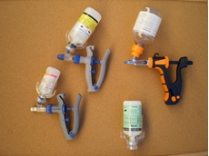 Bottle mount vaccinators for pigs