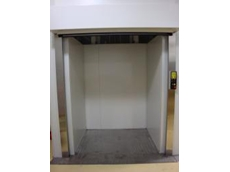 Low profile pitless freight hoists can be freestanding or fitted to an existing shaft
