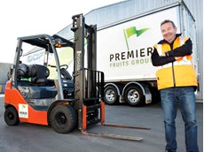 Premier Fruits Group co-founder Joe Petroro with his Toyota forklift