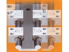 Self-lubricating linear guide systems.
