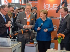 German Federal Chancellor Dr Angela Merkel and Swedish Prime Minister Stefan Löfven visited the igus stand at the Hannover Messe