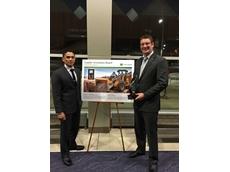 Trimble LOADRITE Regional Manager Nigel Kurtz and Marketing Manager Elliot Chisholm receive Deere Supplier Innovation Award