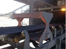 A typical on-conveyor Magnasat field coil assembly installed at a magnetite mine